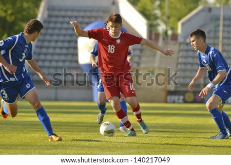 LEGNICA, POLAND - MAY 15: Dariusz Formella (16) in action during match youth representation U-19 between Poland - Bosnia and Herzegovina  on May 15, 2013 in Legnica, Poland. - stock photo
