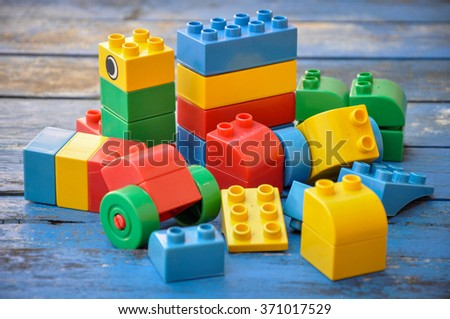 lego plastic toy blocks on blue wood table - stock photo