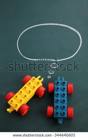lego toy car with speech bubble - stock photo