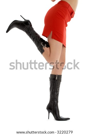 legs and back of lady in red skirt over white - stock photo