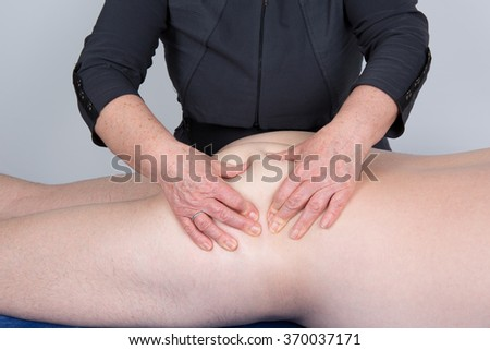 Legs and buttocks man massage to reduce cellulite - stock photo