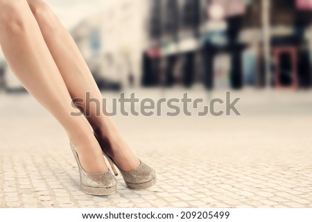 legs and city  - stock photo