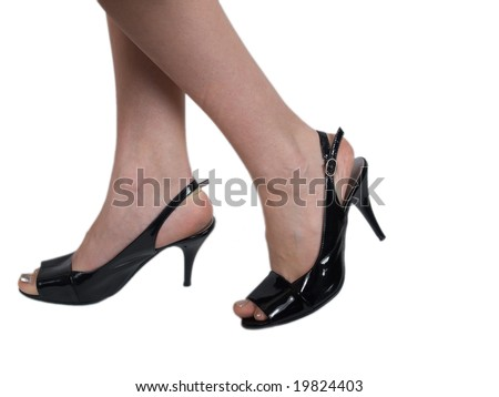 Legs and high heels isolated on a white background