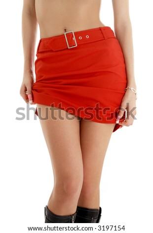 legs and hips of tanned lady in red skirt - stock photo