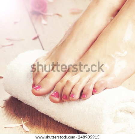 Legs and towel. Spa, recreation and skin care concept.  - stock photo