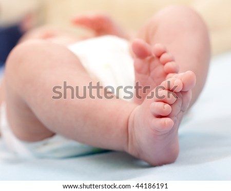 Legs baby. 2 months from the moment of birth. - stock photo