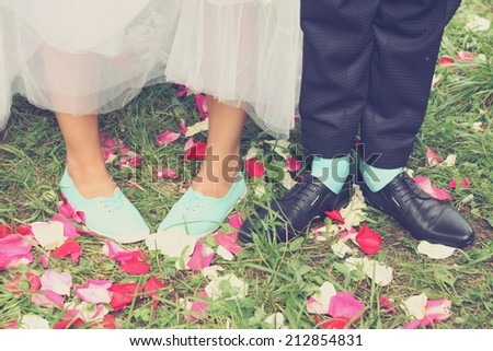 Legs bridal, groom wearing shoes, bride's moccasins