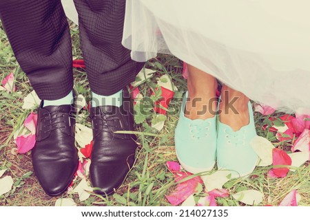 Legs bridal, groom wearing shoes, bride's moccasins - stock photo