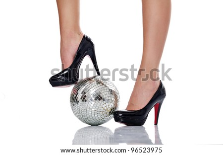 legs in black elegant high heel with disco ball, isolated on white background - stock photo