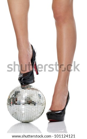 legs in black  high heel with disco ball, isolated on white background - stock photo