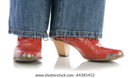 legs in jeans wearing red cowboy boots on white - stock photo
