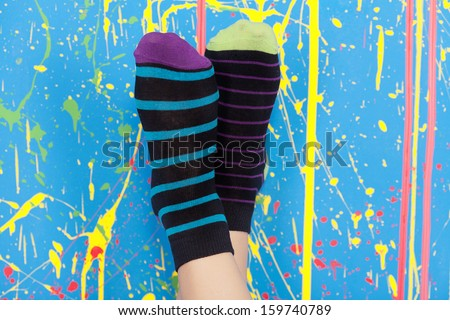 legs in striped socks - stock photo