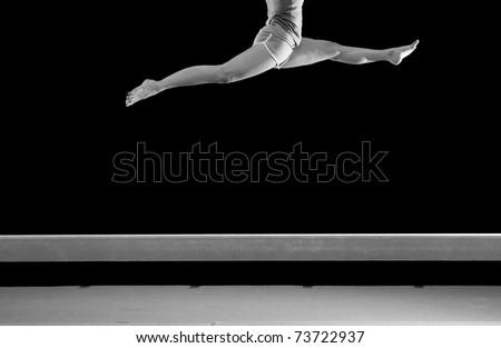 legs jump on balance beam - stock photo