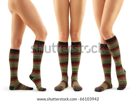 legs long female in striped socks isolated on white background - stock photo