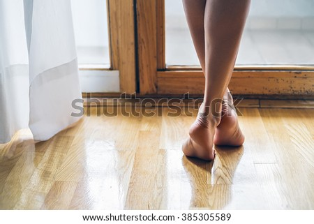 legs of a elegant and barefoot girl - stock photo