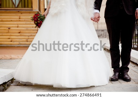 Legs of a groom and a bride. - stock photo