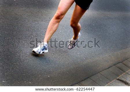 legs of a marathon runner during a competition - stock photo