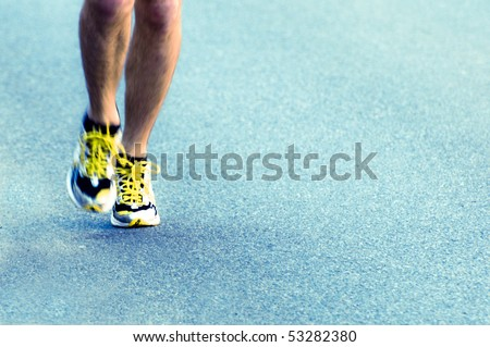 legs of a runner during a marathon - stock photo