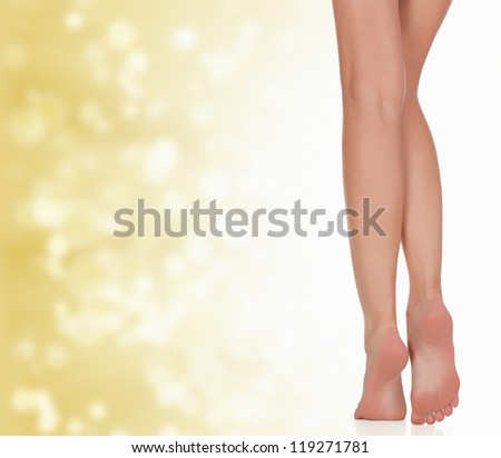 Legs of a woman against abstract background with circles and copyspace. - stock photo