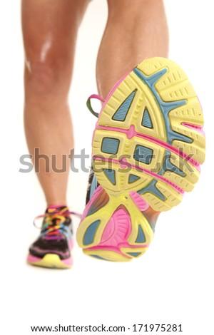 Legs of a woman in sneakers walking forward. - stock photo