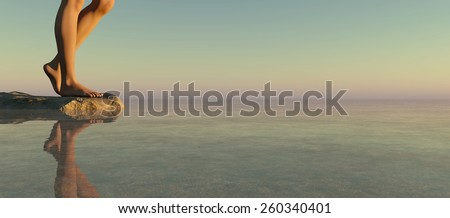 Legs of a woman on a rock watching a sunset - stock photo