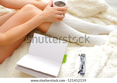 Legs of a young girl drinking coffee