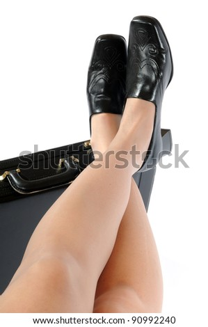 Legs of an attractive woman in front of a white background - stock photo