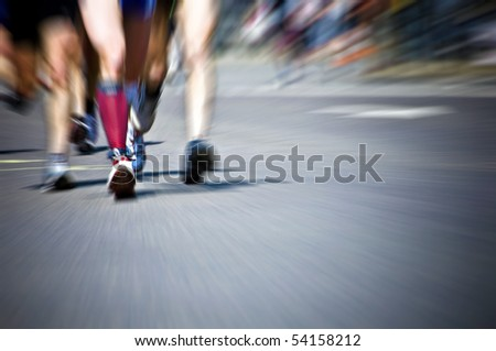 legs of athletes during a marathon - stock photo