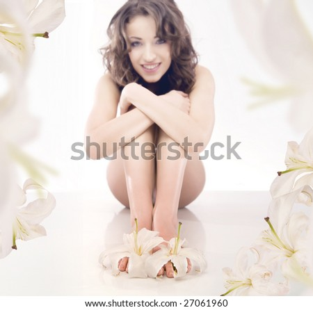 legs of beautiful girl with lily - stock photo