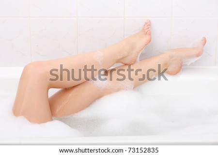 Legs of beautiful young caucasian female in bath