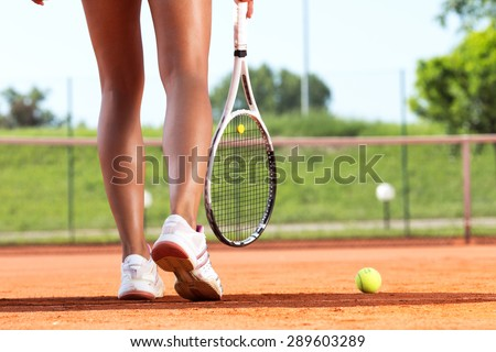 Legs of female tennis player.Close up image. - stock photo