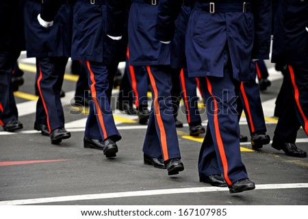 Legs of military personnel are seen during a national day military parade - stock photo