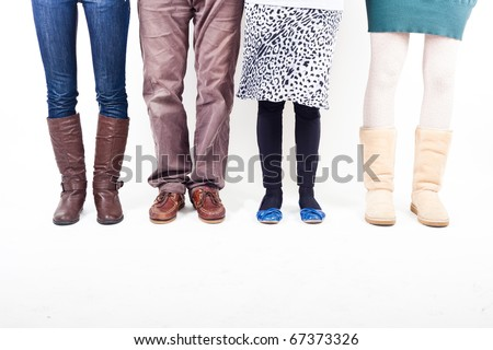 Legs of People with Different Casual Clothes - stock photo
