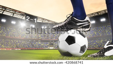 legs of soccer or football player at stadium - stock photo