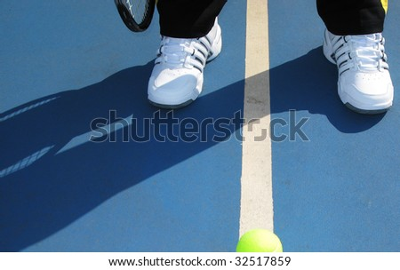 Legs of  tennis player on court,  shadow,  line and ball - stock photo