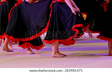 legs of the dancers during the performance of flamenco dancing - stock photo