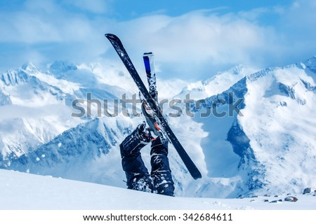 Legs of the skier lying in snow at the ski resort - stock photo
