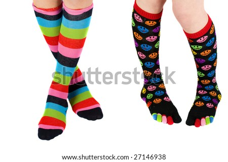 Legs of two schoolgirls with colorful stockings