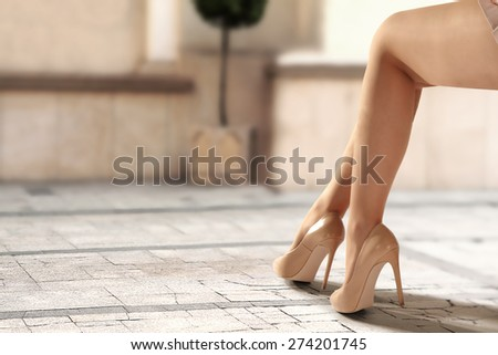 legs of woman and heels  - stock photo