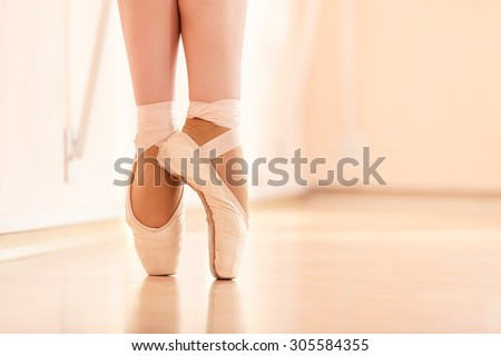 Legs of young ballerinas, ballet dancing class - stock photo