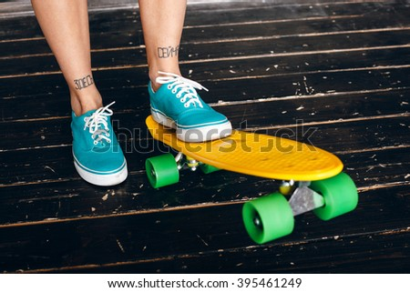 legs of young girl on longboard. Skateboarding. lifestyle - stock photo