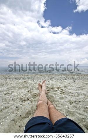 legs on beach - stock photo
