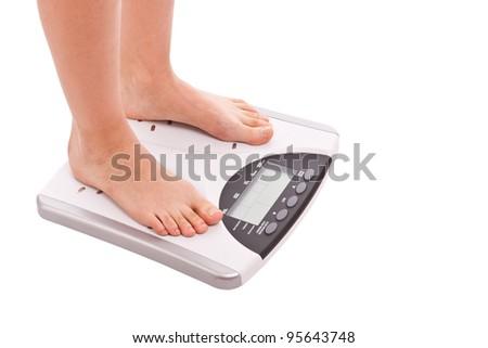 legs on scales isolated in white background - stock photo
