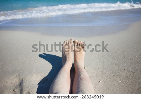legs on the beach, female feet in  sand - stock photo