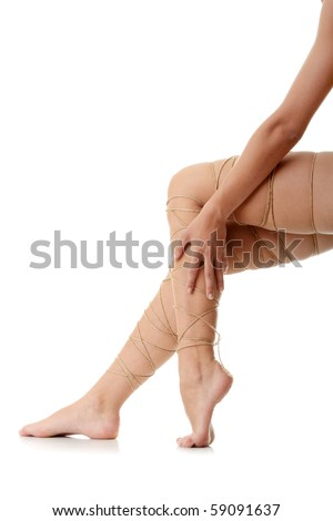 Legs pain concept - legs tied with rope isolated on white