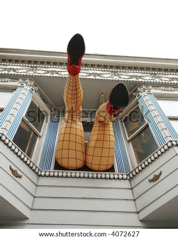 Legs sticking out the window on Haight street. San Francisco, California USA - stock photo