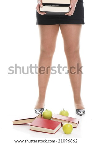 legs with books - stock photo