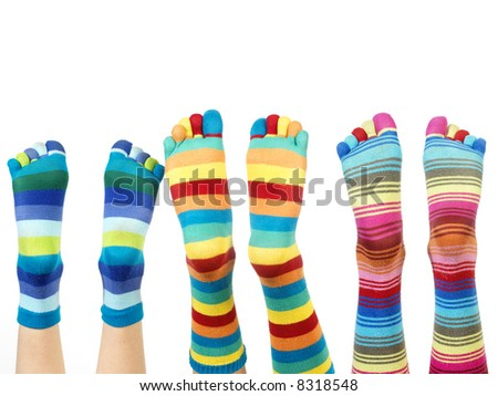 legs with colorful socks (isolated on white) - stock photo
