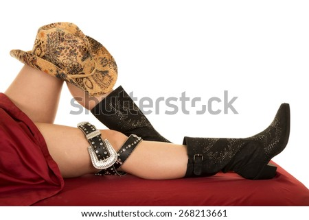 Legs with cowboys boots on them.  A child's and an adult. - stock photo