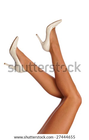 Legs with high heels isolated against a white background - stock photo